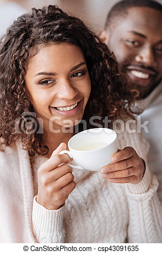 Smiling African American couple drinking tea in the cafe - csp43091635