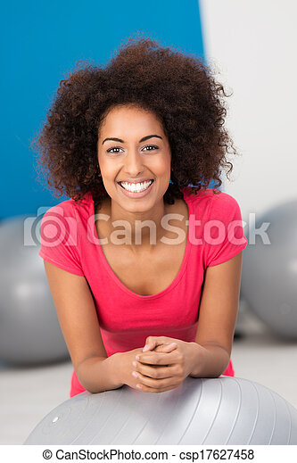 Smiling African American woman in a gym - csp17627458