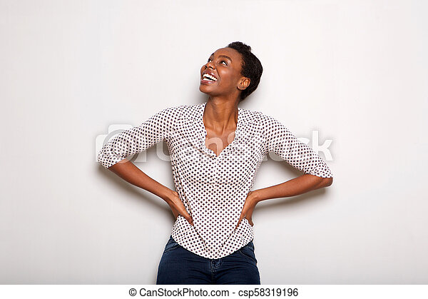 smiling african american woman standing isolated on white background - csp58319196