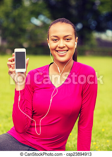 smiling african american woman with smartphone - csp23894913