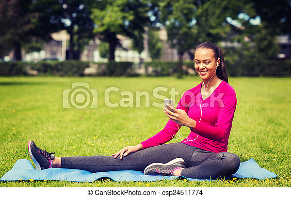 smiling african american woman with smartphone - csp24511774