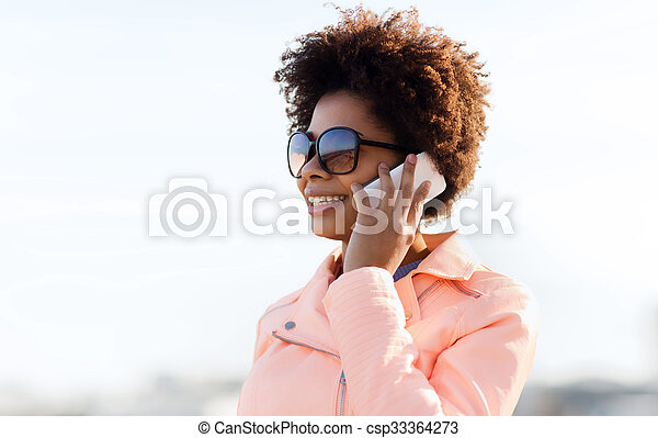 smiling african american woman with smartphone - csp33364273