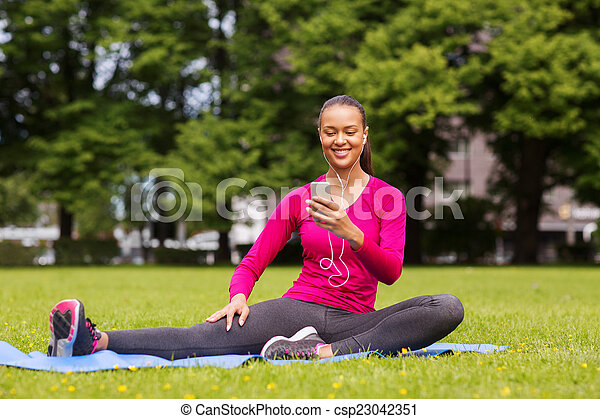 smiling african american woman with smartphone - csp23042351