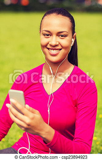smiling african american woman with smartphone - csp23894923