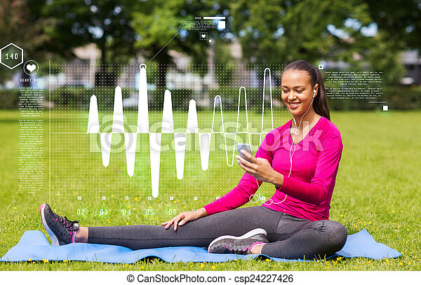 smiling african american woman with smartphone - csp24227426