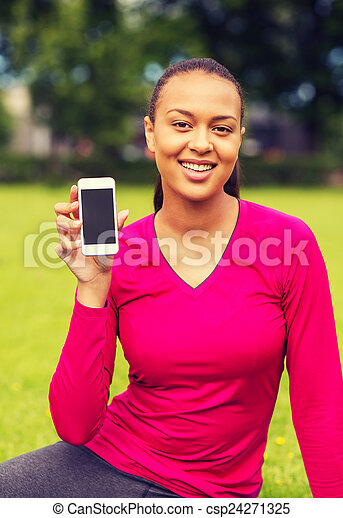 smiling african american woman with smartphone - csp24271325