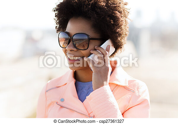 smiling african american woman with smartphone - csp27361327