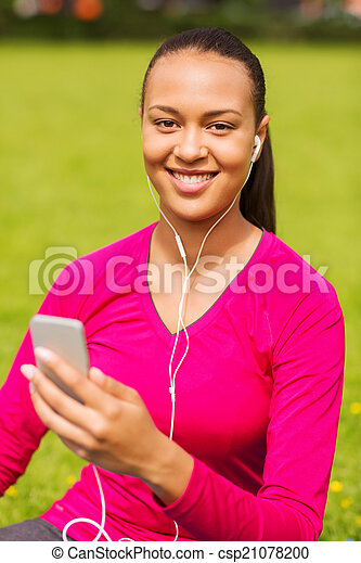 smiling african american woman with smartphone - csp21078200