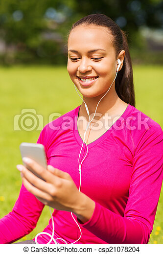 smiling african american woman with smartphone - csp21078204