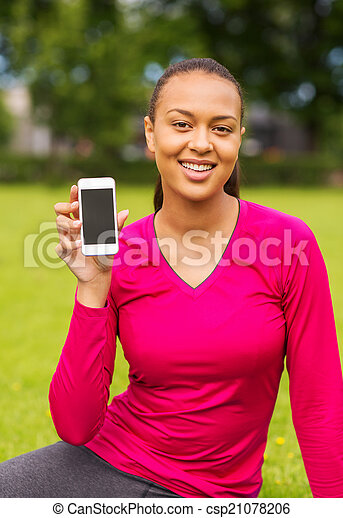 smiling african american woman with smartphone - csp21078206