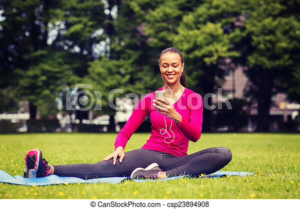 smiling african american woman with smartphone - csp23894908