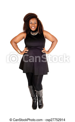 Smiling African woman standing. - csp27752914