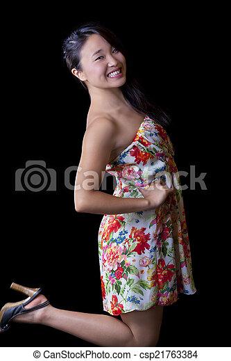 Smiling Asian American Woman Dress Standing Studio - csp21763384