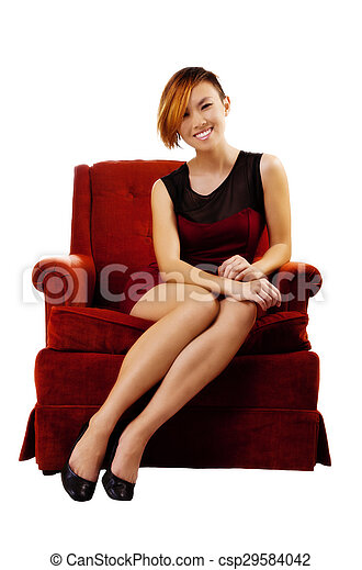 Smiling Asian American Woman Sitting In Red Dress - csp29584042