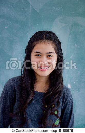 Smiling Asian woman - csp18188676