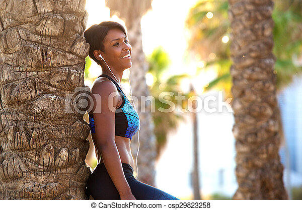 Smiling attractive african american sporty woman - csp29823258