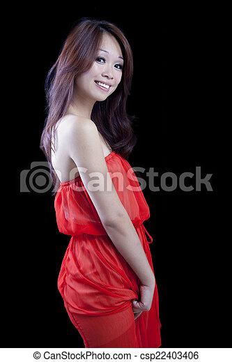 Smiling Attractive Asian American Woman Orange Dress - csp22403406