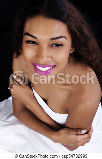 Smiling Attractive Latina Woman Wrapped In Sheet - csp54732993
