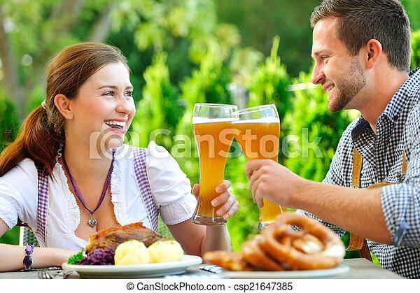 Smiling bavarian couple at Oktoberfest - csp21647385
