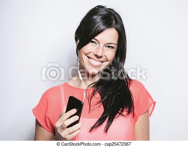 Smiling black hair woman on grey background - csp25472367