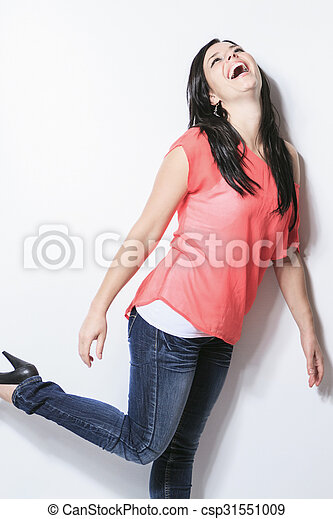 Smiling black hair woman on grey background - csp31551009