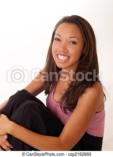Smiling black woman with braces on upper teeth - csp2162669