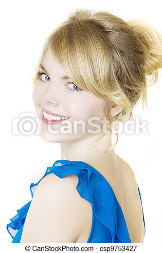 Smiling blond woman in blue - csp9753427
