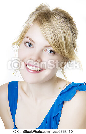 Smiling blond woman in blue - csp9753410