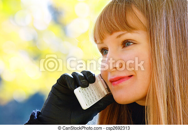 Smiling blonde with phone looks right - csp2692313