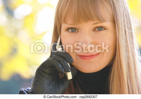 Smiling blonde with phone - csp2692307