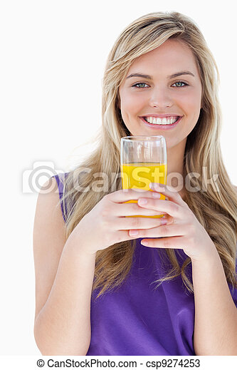 Smiling blonde woman holding an orange juice - csp9274253