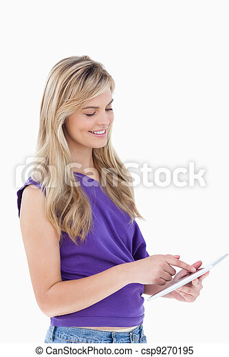 Smiling blonde woman using a tablet computer - csp9270195