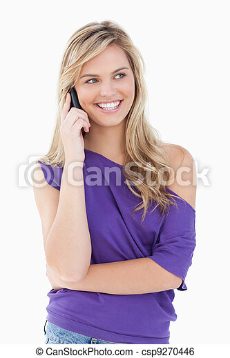 Smiling blonde woman using her mobile phone - csp9270446