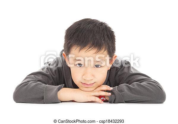smiling boy is lying on the floor - csp18432293