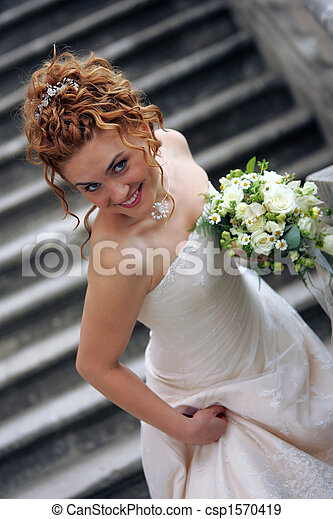 Smiling bride with bouquet - csp1570419