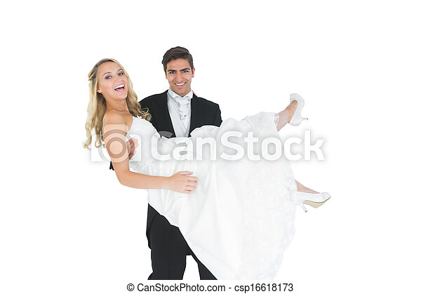 Smiling bridegroom lifting his wife up - csp16618173