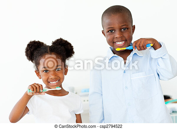 Smiling brother and sister brushing their teeth  - csp2794522