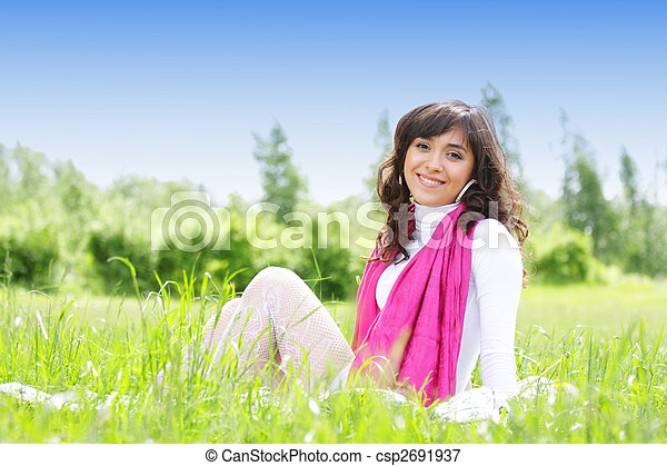 Smiling brunette in grass - csp2691937