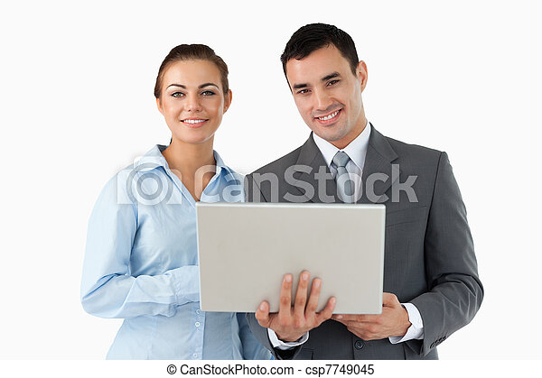 Smiling business partners with laptop - csp7749045