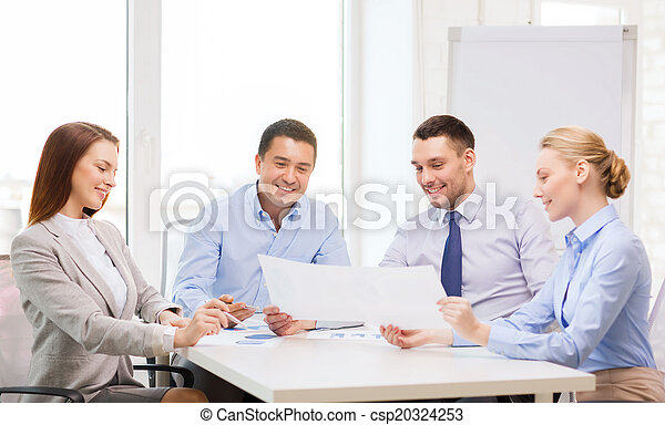 smiling business team having discussion in office - csp20324253