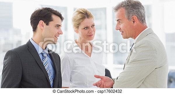 Smiling business team talking together - csp17602432