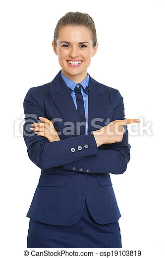 Smiling business woman pointing on copy space - csp19103819