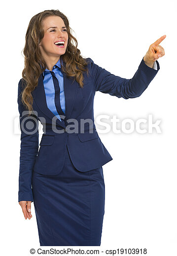 Smiling business woman pointing on copy space - csp19103918