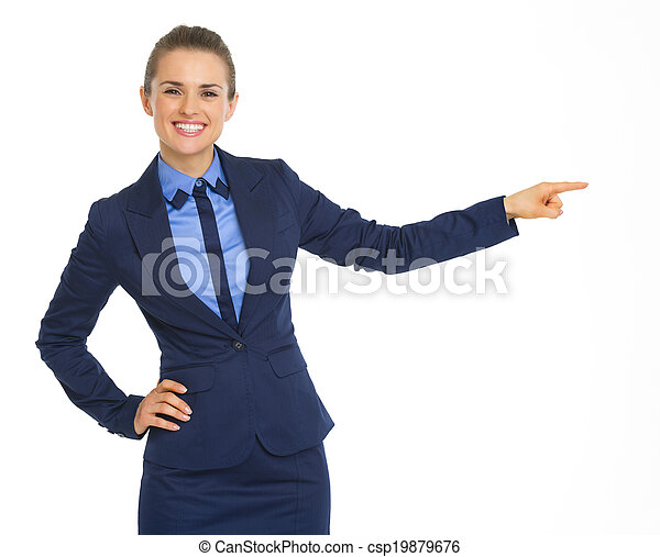 Smiling business woman pointing on copy space - csp19879676