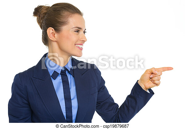 Smiling business woman pointing on copy space - csp19879687