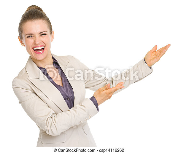 Smiling business woman pointing on copy space - csp14116262