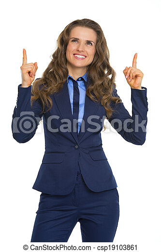 Smiling business woman pointing on copy space - csp19103861
