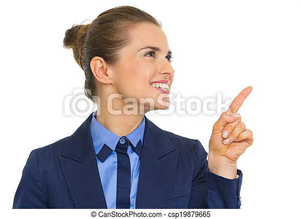Smiling business woman pointing on copy space - csp19879665
