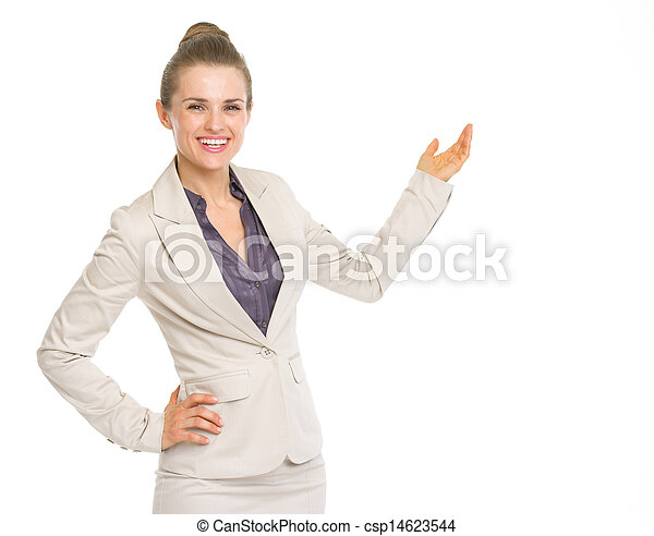 Smiling business woman pointing on copy space - csp14623544
