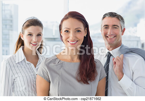 Smiling business woman with colleagues  - csp21871662